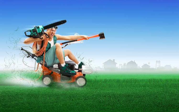 Crazy workman covered with instruments driving lawn mower
